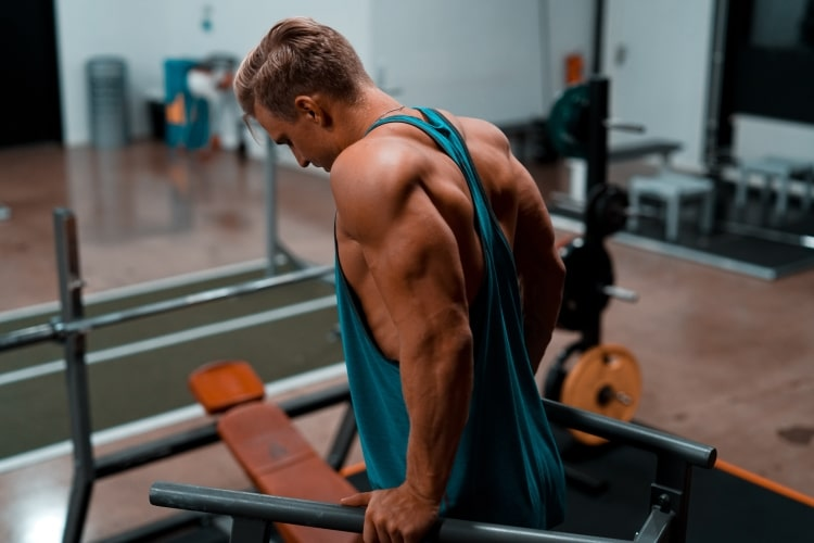 Man Exercising on Parallel Bars