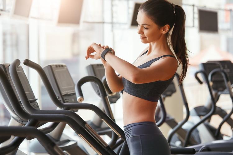 Woman Checking Cardio Workout Progress