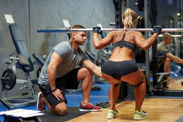 Woman and Personal Trainer Squats