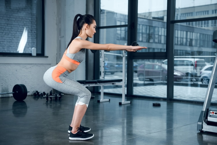 Young Sporty Woman Doing Squats
